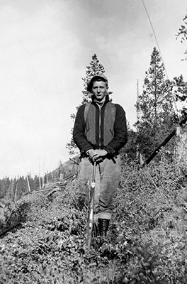 """Stephen Kuleski hunting near his home in Michel-Natal B.C. prior to his enlistment in the Royal Canadian Air Force. An avid hunter and fisherman, he took great pleasure in the Outdoor Life magazines that his parents mailed him while he was serving overseas. """"The magazines help remind me of home,"""" he wrote in a letter to his parents."""
