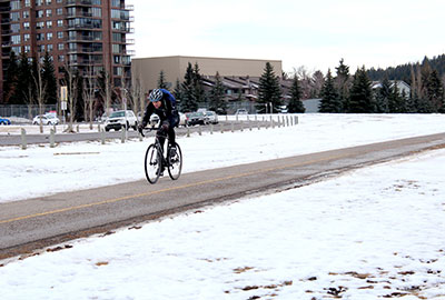 Biker on the Bow River path