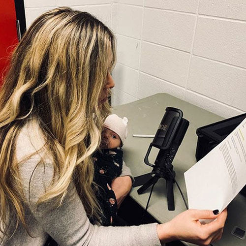Kristin Hallett records her voice over for the Flames Foundation while holding her daughter, Perrin back in December 2017. Photo courtesy of Kristin Hallett.
