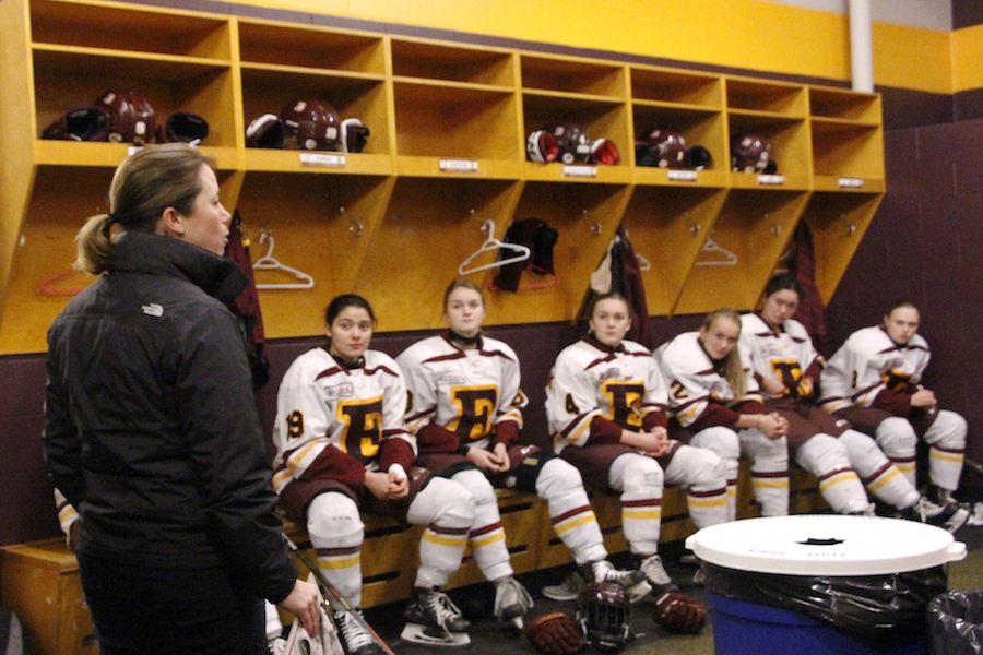 Carla MacLeod prepares her players with a quick message in the dressing room before their game against Banff. Photo by Jasmine Krawchuk