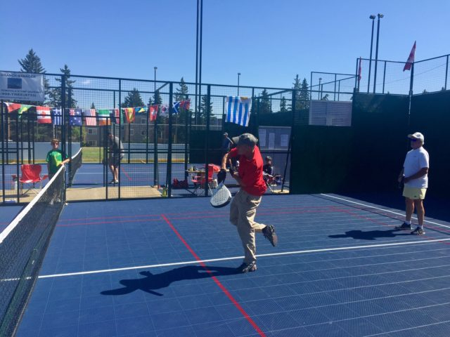 Player has smashed the ball during a padel game at the Calgary Padel Club