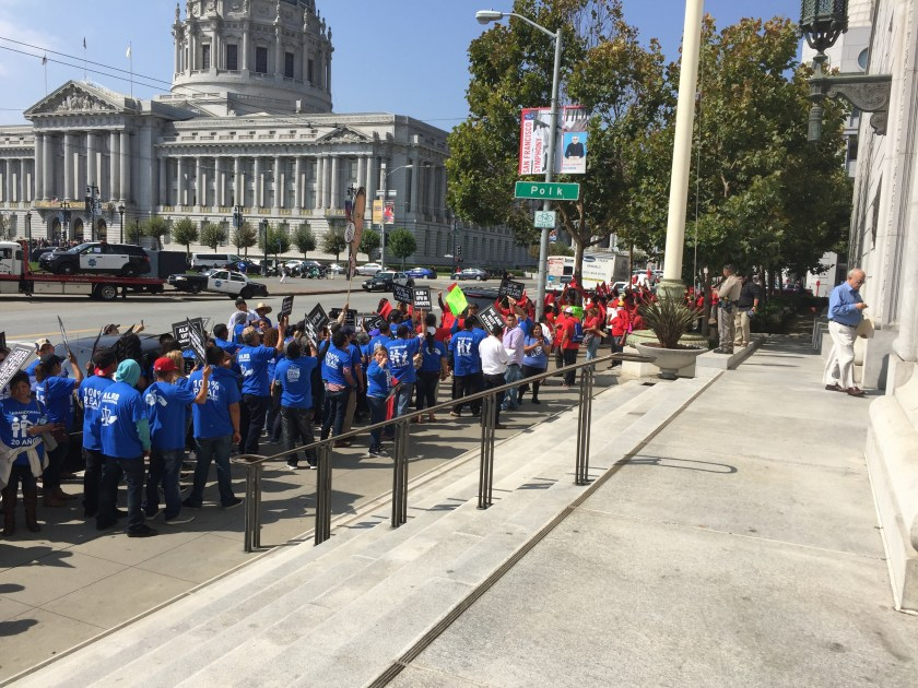 Protesting are Gerawan farm workers (in blue) and UFW members (in red)