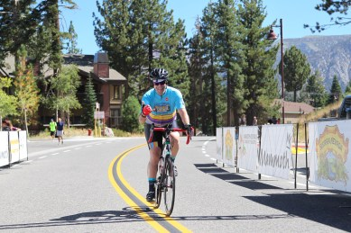 Mark coming up the hill to the finish of the Medio version of the Mammoth Gran Fondo. Flashing the hang loose sign with tongue hanging.