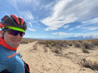 Taking a break from the running the sand gauntlet. Fun fish tailing and sliding around! Carson Range to the right.