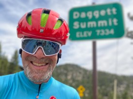 Portrait of Mark in front of the Daggett Summit sign after the AACC TT.