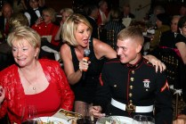 Mary Hermansen serenades a US Marine at a USO Event