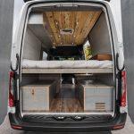 Mercedes Sprinter camper van rear view showing bed, garage and ceiling.