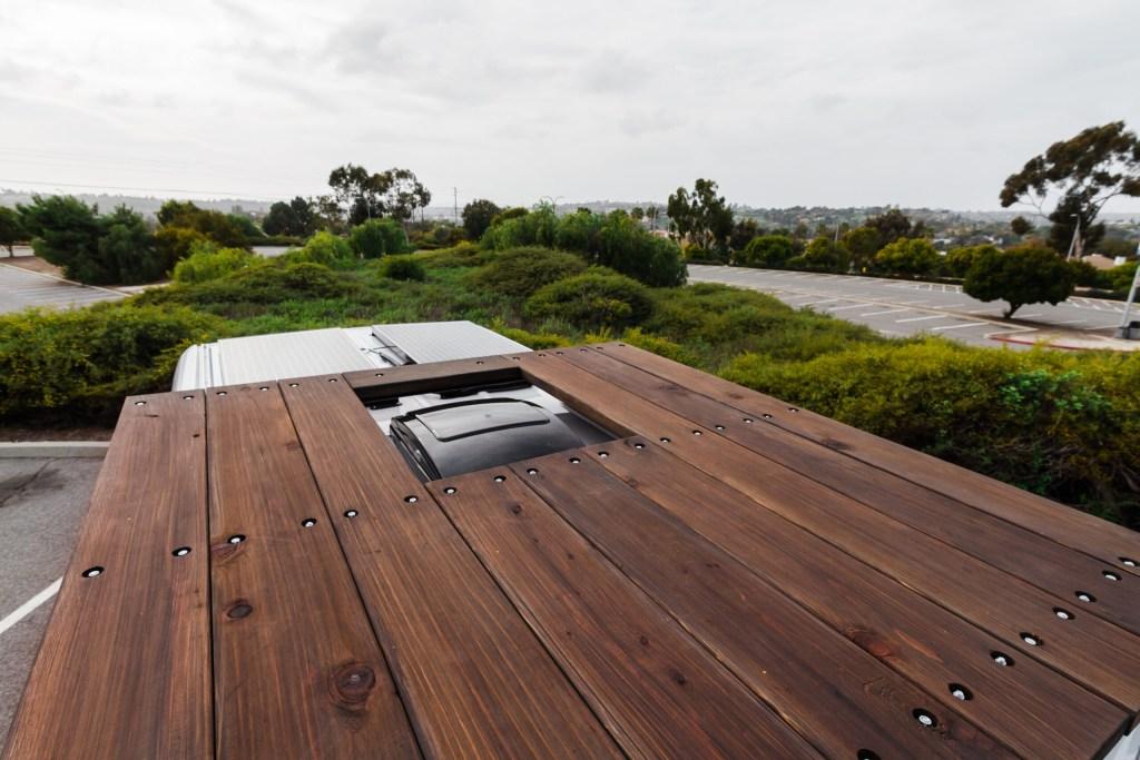 Camper van roof deck, solar panels and maxxfan.