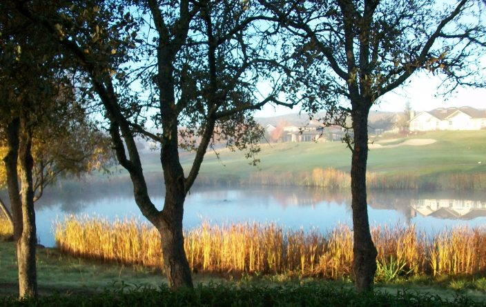 Sunrise over a pond at Copper Valley Golf Course in Copperopolis, Calaveras County, California