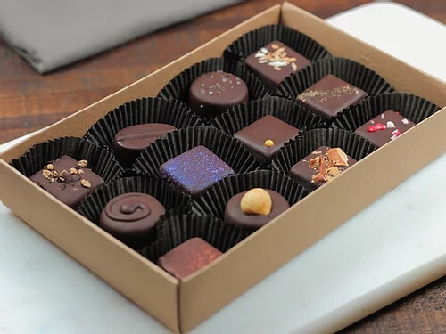 A box of chocolate truffles from Mama Ganache Artisan Chocolates, a gourmet gift idea