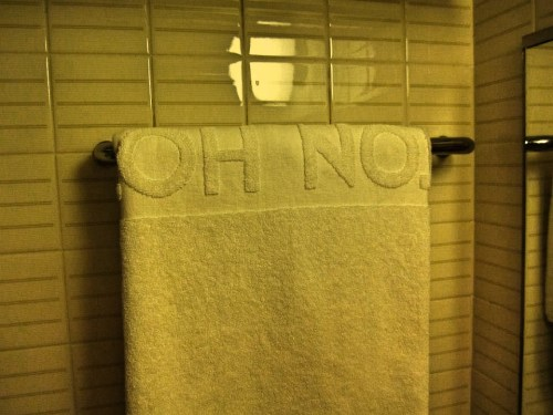 """Hotel towel that says """"oh no"""""""
