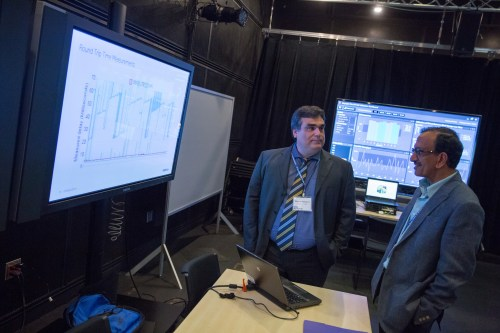 small resolution of marcos tavares of bell labs left chats with uc san diego professor of electrical engineering bhaskar rao at the demo session during the 5g beyond forum