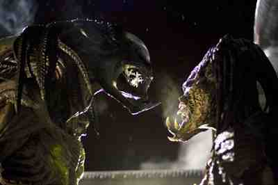 A race of Predators faces off with a whole nest of Xenomorph aliens.