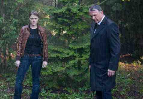 Sam Neill and Sarah Jones as Emerson Hauser and Rebecca Madsen in FOX's Alcatraz