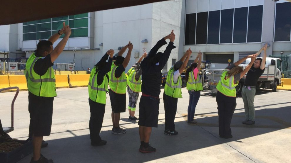 American Airlines pic hi res 1 scaled - El Estretchecito – Stretching at the Workplace for Improved Performance