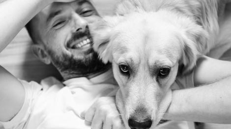 C DOG AND MAN - You and Your Pooch May Have Similar Tummy Bacteria