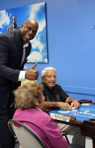 """magic11 194x300 - NBA Legend Earvin """"Magic"""" Johnson joined the City of Hialeah in the inauguration of a Domino Room at the Goodlet Adult Center"""