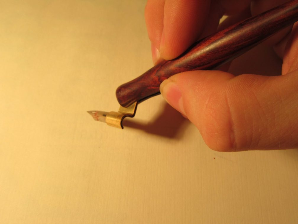 Holding a oblique pen for calligraphy
