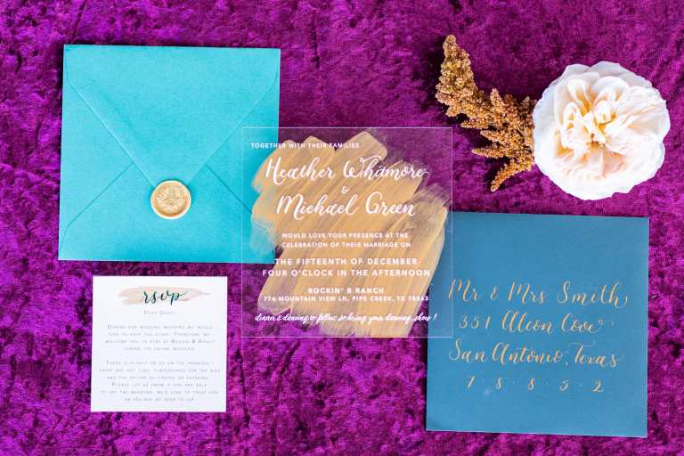 Acrylic Modern Invitation Gold Paint Strokes and teal dark blue details and gold wax seal at Rockin B Ranch by CalliRosa custom wedding invitations in San Antonio Texas