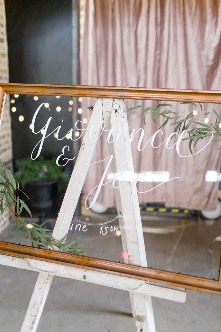 Clear Acrylic Glass Copper Detail Wedding Welcome Sign with White Calligraphy at Park 31 by CalliRosa Calligrapher in San Antonio Texas