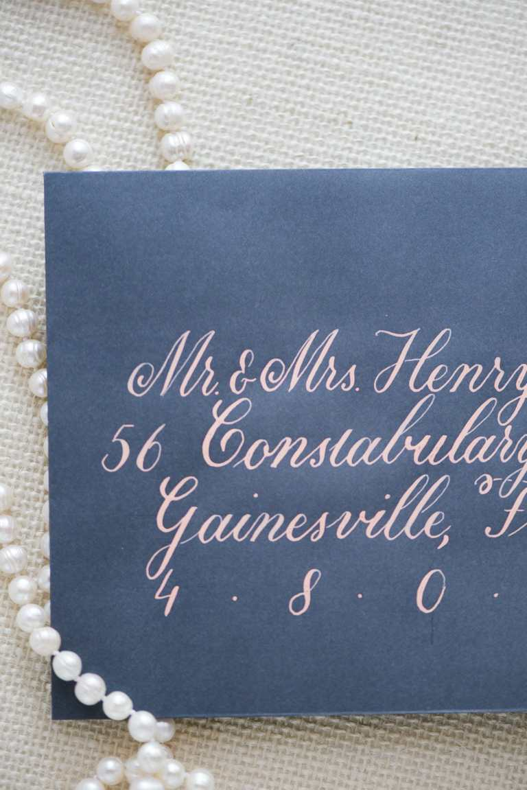 Formal Copperplate Calligraphy Envelopes - Centered by CalliRosa Calligrapher in San Antonio Texas - navy envelope with blush lettering