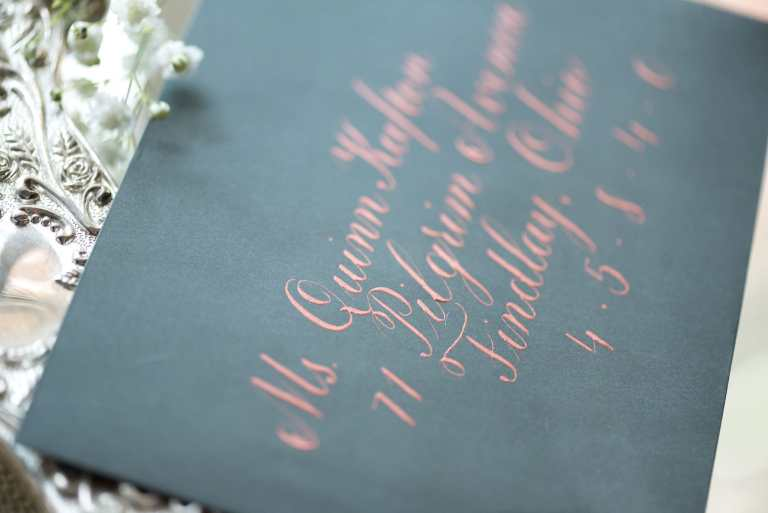Formal Copperplate Calligraphy Envelopes - Staircase by CalliRosa Calligrapher in San Antonio Texas - grey envelope with rose gold lettering