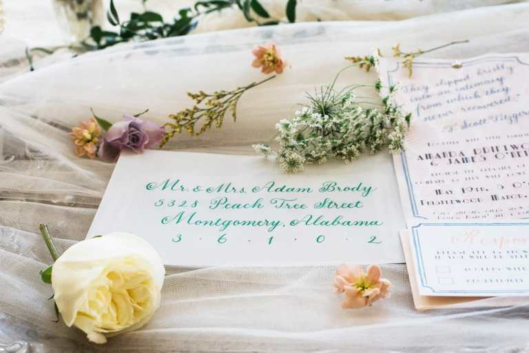 Formal Copperplate Calligraphy Envelopes - Staircase by CalliRosa Calligrapher in San Antonio Texas - vellum envelope with green lettering