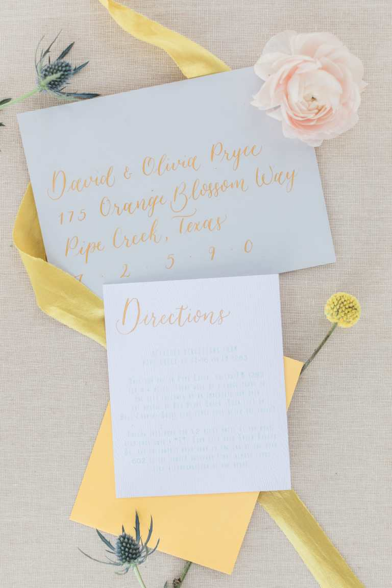 Modern Calligraphy Envelopes - Left Alligned by CalliRosa Calligrapher in San Antonio Texas - grey envelopes with yellow lettering