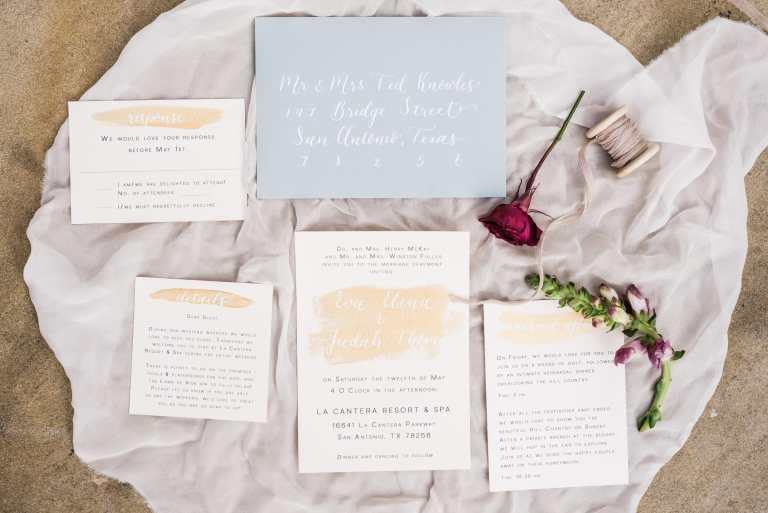 Modern Minimalistic Fine Art Invitation Suite with Gold Paintstrokes and white calligraphy at La Cantera Resort and Spa by CalliRosa Custom Wedding Invitations in San Antonio Texas