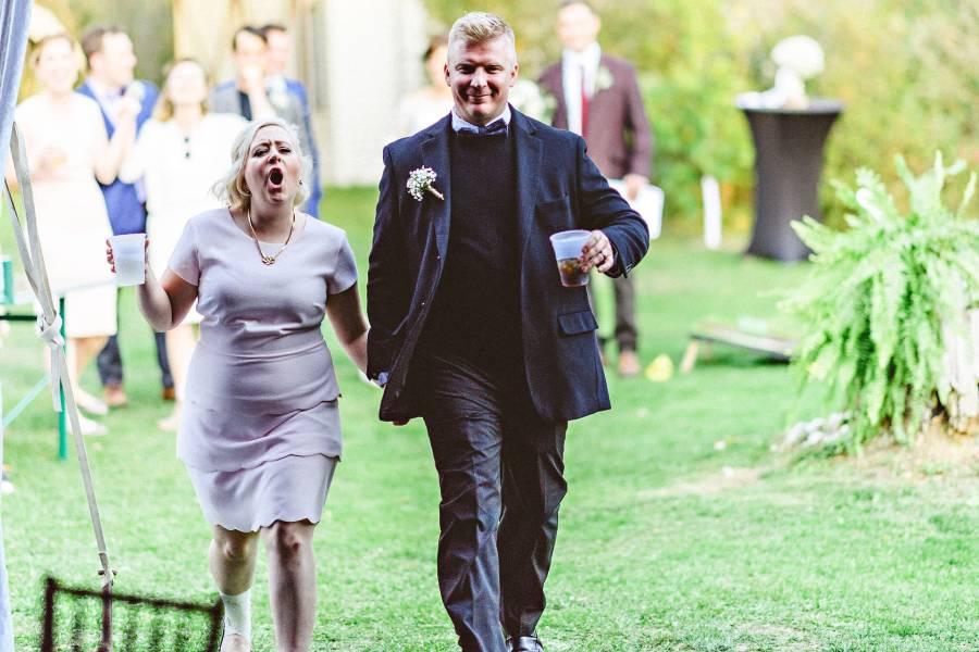 bridesmaid and groomsmen walking into reception