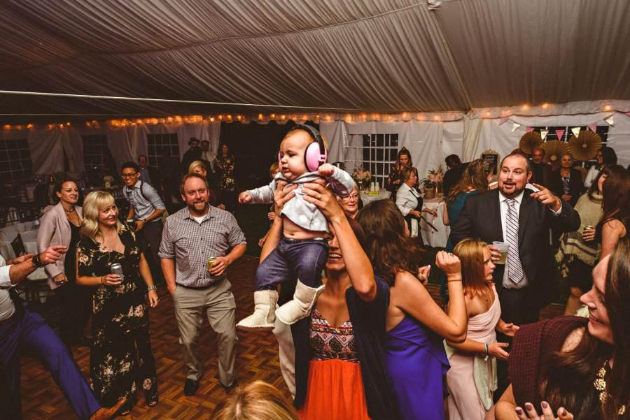 partying toddler at niagara backyard wedding