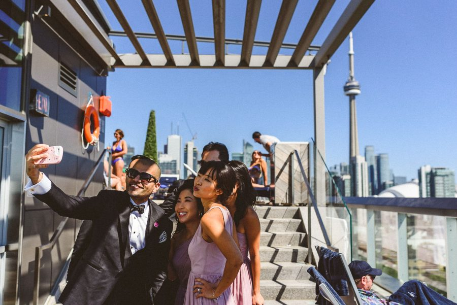 wedding party selfie on rooftop of Thompson Hotel