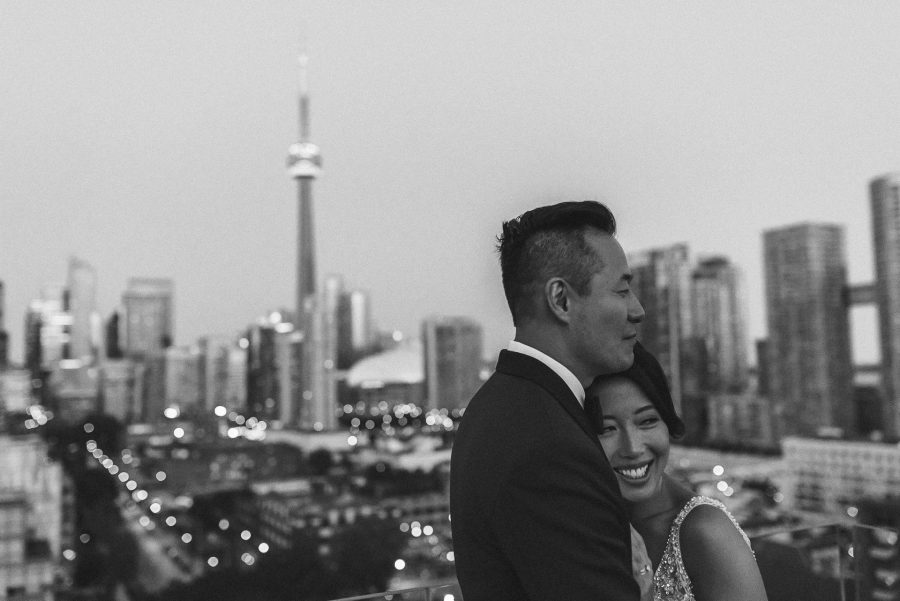 Black and white of couple on top of Thompson Hotel