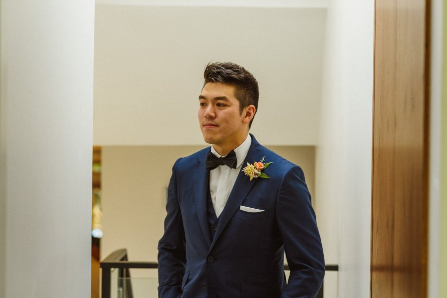 groom portrait in house