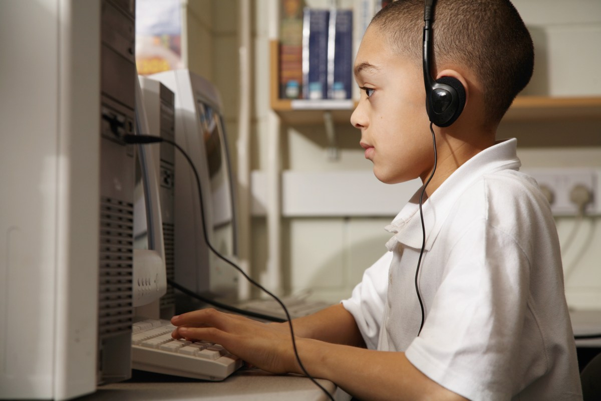 Boy studying at a computer