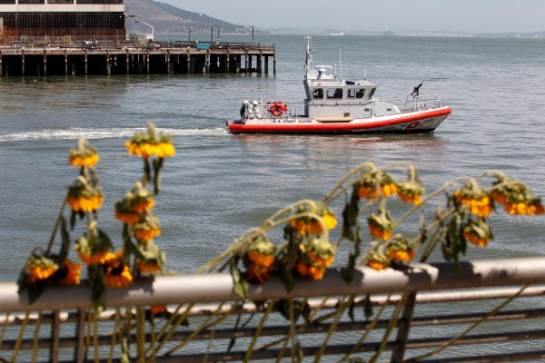 A U.S. Coast Guard boat patrols by Pier 14 following a vigil for Kathryn Steinle, who was gunned down while out for an evening stroll there in 2015. Photo by Beck Diefenbach/ASSOCIATED PRESS