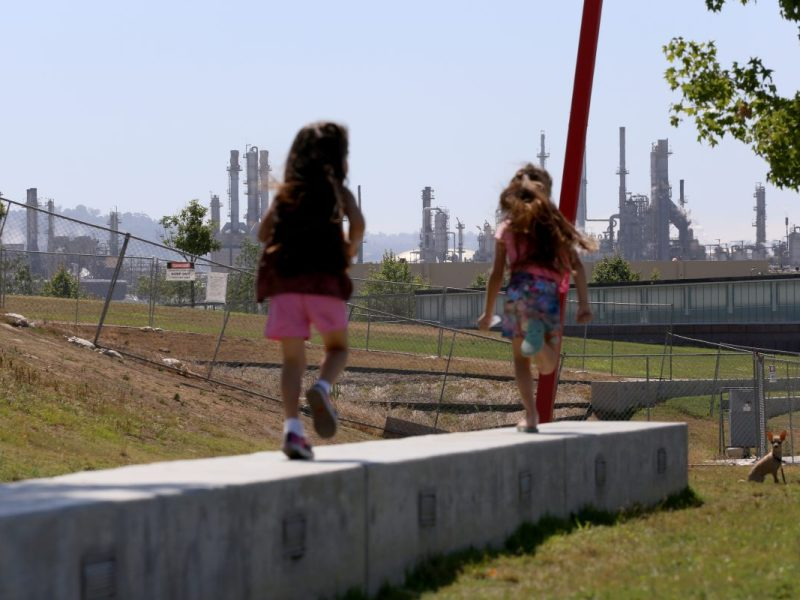 Children at play in Wilmington, California—their neighborhood adjacent to industry. Photo by Iris Schneider for CALmatters