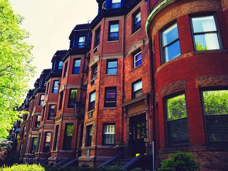 Housing lines the street of a classic Boston neighborhood. Photo via Pixabay