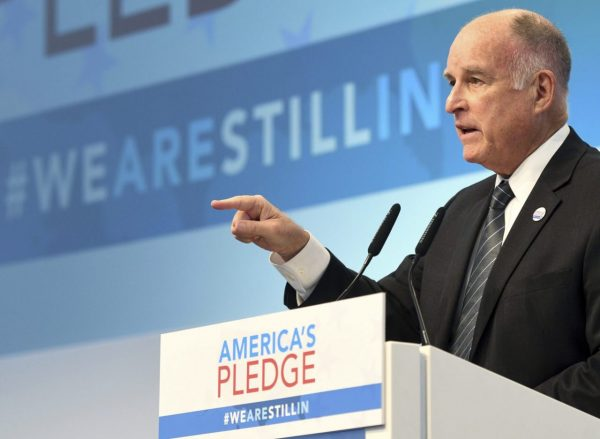 "California governor Jerry Brown speaking in the tent of the climate initiative ""America's Pledge"" during the World Climate Conference this week in Bonn, Germany. Photo by Henning Kaiser via AP Images."