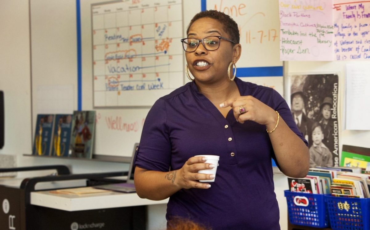 Tachelle Herron teaches humanities to 7th graders at Willie Brown Jr. Middle School in San Francisco. Photo by Penni Gladstone for CALmatters