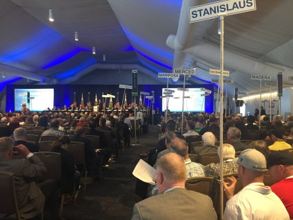 Delegates sit under a tent waiting to vote to endorse a candidate at the California Republican Party state convention in San Diego
