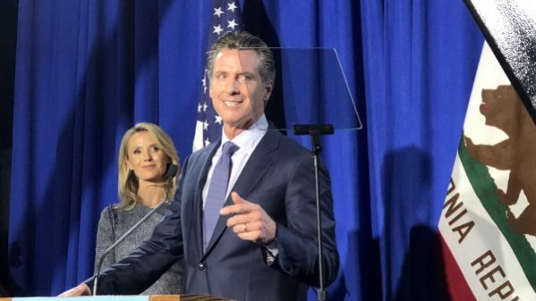 Gavin Newsom delivers a primary victory speech that he said wasn't a victory speech before supporters in San Francisco. Photo by Byrhonda Lyons for CALmatters
