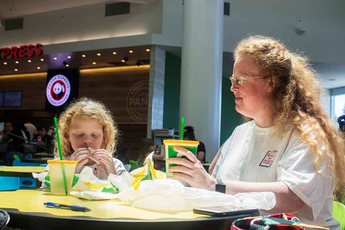 Thea Wickelgren, left, eats lunch with her mom, Emily Wickelgren, who is holding a soda.