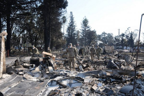 Sifting through the debris of the 2017 wildfire in Santa Rosa. Photo via California National Guard