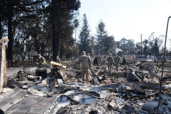 Sifting through the debris of the 2017 wildfire in Santa Rosa. Photo via California National Guard