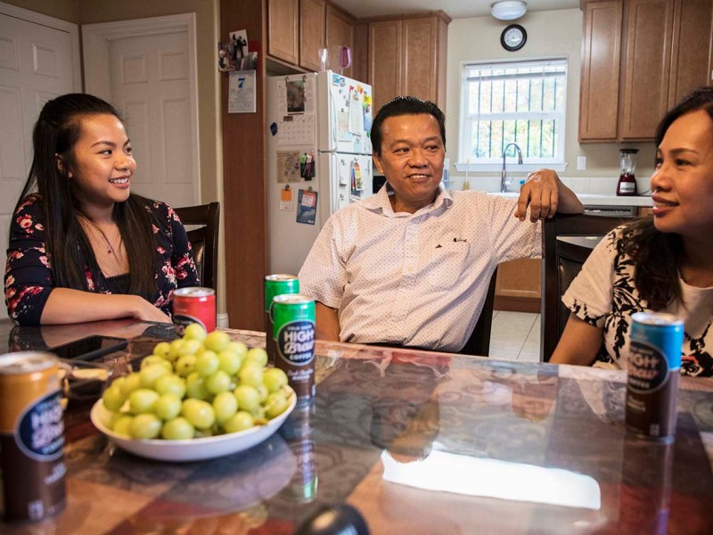 Jenny Nguyen, with her parents Khanh Nguyen and Tammy Vo, sitting in their home in Sacramento built by Habitat for Humanity. Photo Credit: Robbie Short