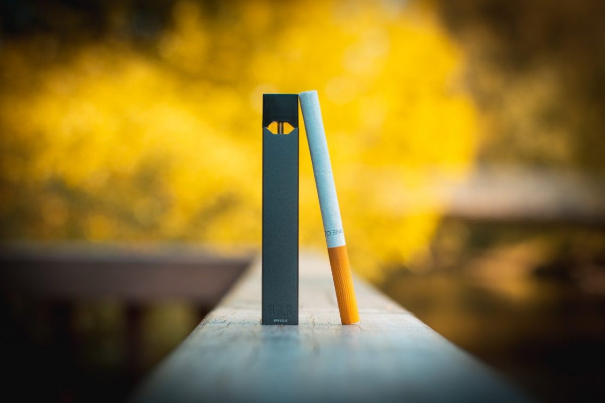 A JUUL e-cigarette, left, and a regular cigarette. Flickr photo courtesy of vaping360.com