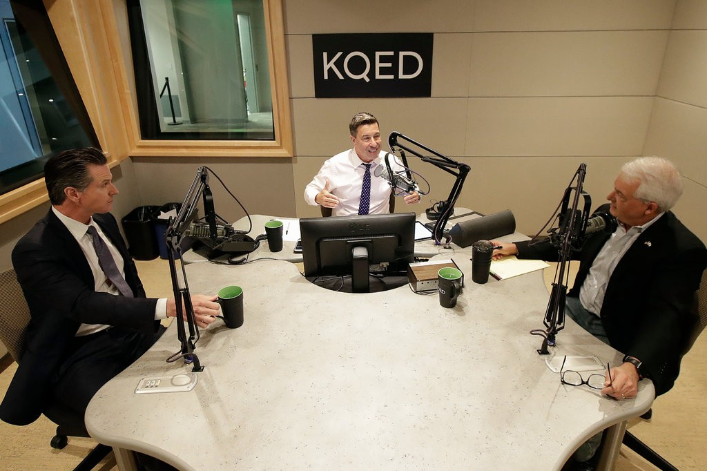 The debate between Gavin Newsom, left, and John Cox, right, moderated by Scott Shafer of KQED this morning. Pool photo by Jeff Chiu