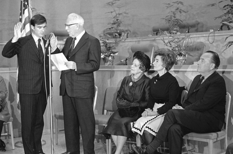 Jerry Brown was sworn at California's Secretary of State by former U.S. Chief Justice Earl Warren at ceremonies on Jan. 4, 1971, with former Gov. Pat Brown looking on. Photo by Associated Press