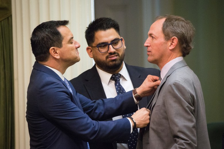 Assembly Speaker  Anthony Rendon, left, adjusts the tie of Assemblyman Brian Maienschein before members of the Assembly are sworn in, December 3, 2018, at the Capitol in Sacramento.